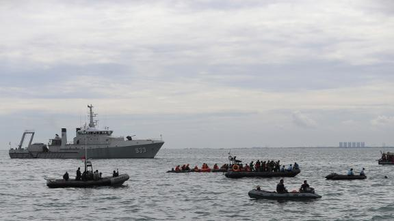 Indonesian Navy divers take part in a search operation near Jakarta.