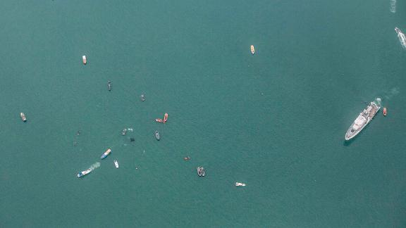 In this aerial photo, rescuers search for plane wreckage on Sunday, January 10.