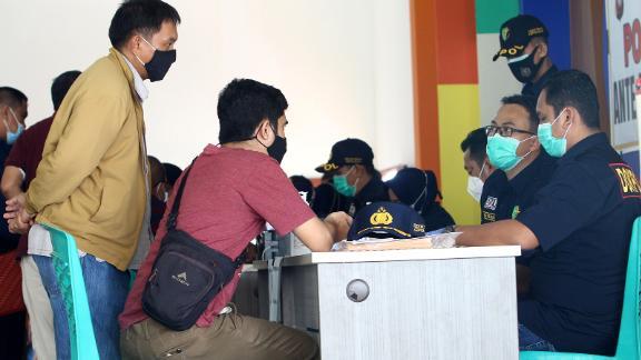 Passengers' family members gather at the Supadio International Airport near Pontianak.