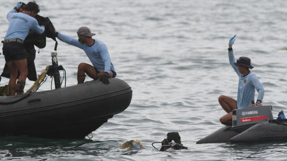 Indonesian Navy divers find parts of the plane wreckage in Thousand Islands waters, near Jakarta.