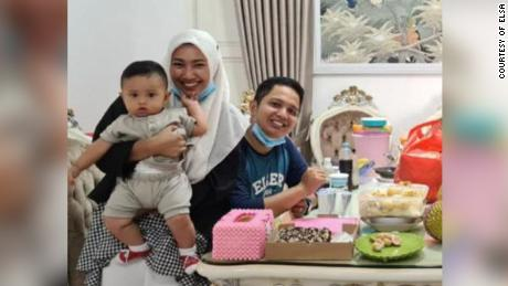 Rizki Wahyudi, 26, and his wife, Indah Halimah Putri, 26, are seen with their 7-month-old son, Arkana Nadhif Wahyudi.