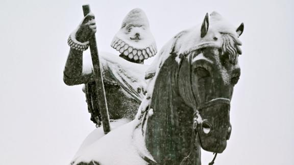 The statue of King Philip III of Spain created in 1616 by Jean Boulogne and Pietro Tacca is covered with snow at Plaza Mayor amid a heavy snowfall in Madrid on January 9, 2021.