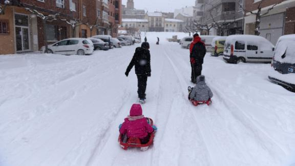 Children play in the snow during the Filomena heavy snowfall in Almazan, Spain.