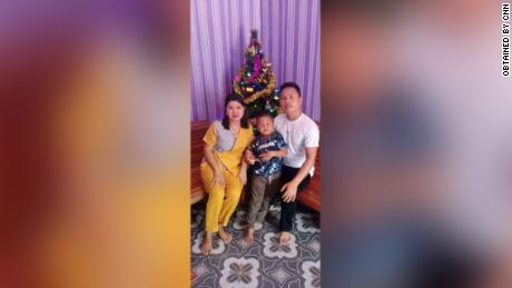 Yohanes Suherdi, 30, poses with his wife Susilawati Bungahilaria and their 5-year-old son, Rian Gusti Rafael, in this Christmas portrait.