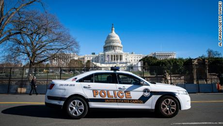2 Capitol Police officers suspended and at least 10 more under investigation for alleged roles in riot