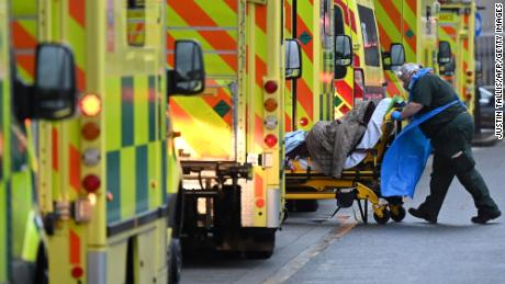 A row of ambulances in London in January.  Health workers fear similar scenes this winter if infections continue to climb.