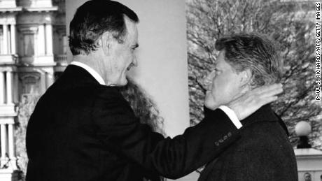 President George H.W. Bush greets President-elect Bill Clinton upon his arrival to the White House on Inauguration Day in 1993.