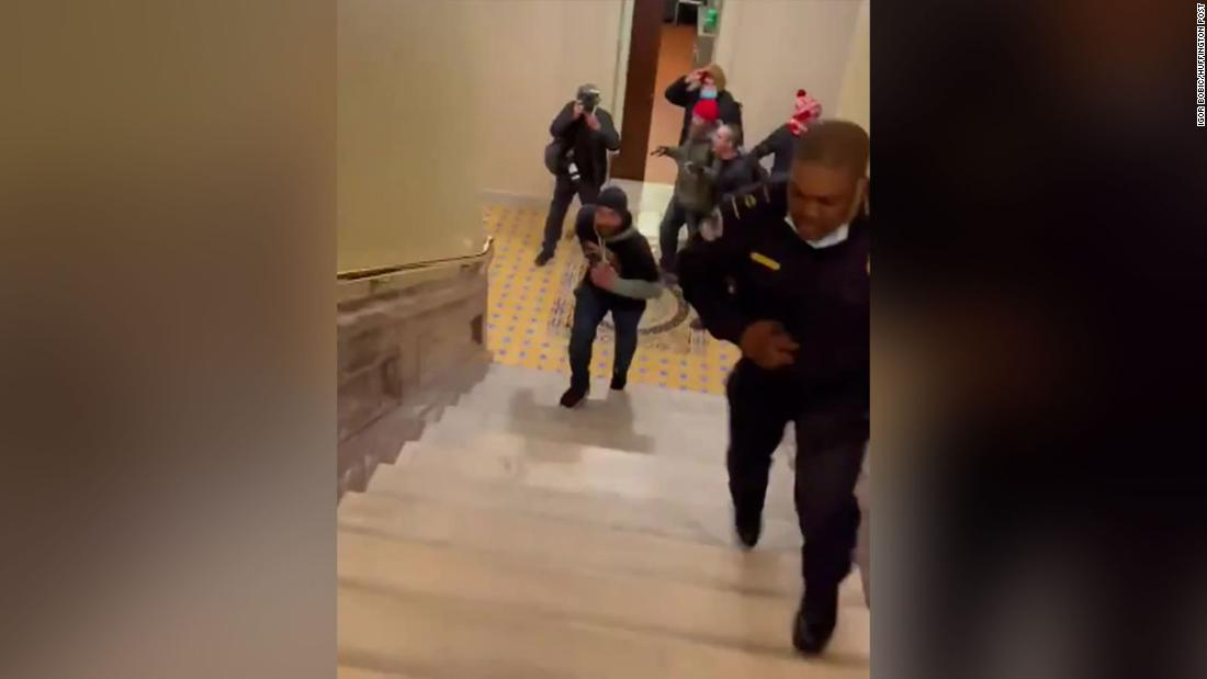Lawmakers want to award a Congressional Gold Medal to the Capitol Police officer who lured rioters away from the Senate chambers – CNN