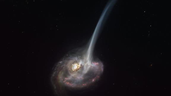 "This artist's impression of the distant galaxy ID2299 shows some of its gas being ejected by a ""tidal tail"" as a result of a merger between two galaxies."