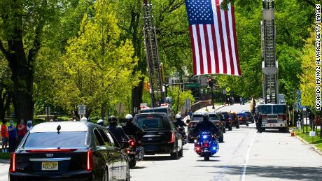 An American flag hangs over the funeral procession of Glen Ridge Police Officer Charles Roberts in New Jersey on May 14, 2020. Roberts was the first officer on the force to die of Covid-19.