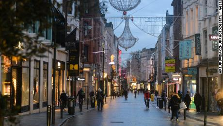 People walk down Grafton Street in Dublin city center on January 6 after lockdown measures were reimposed.