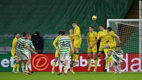 David Turnbull opens the scoring at Celtic Park.