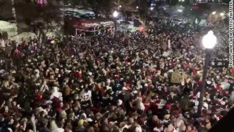 Alabama Crimson Tide fans flood the streets of Tuscaloosa on Monday night after their team secured the national title with an emphatic win over Ohio State.