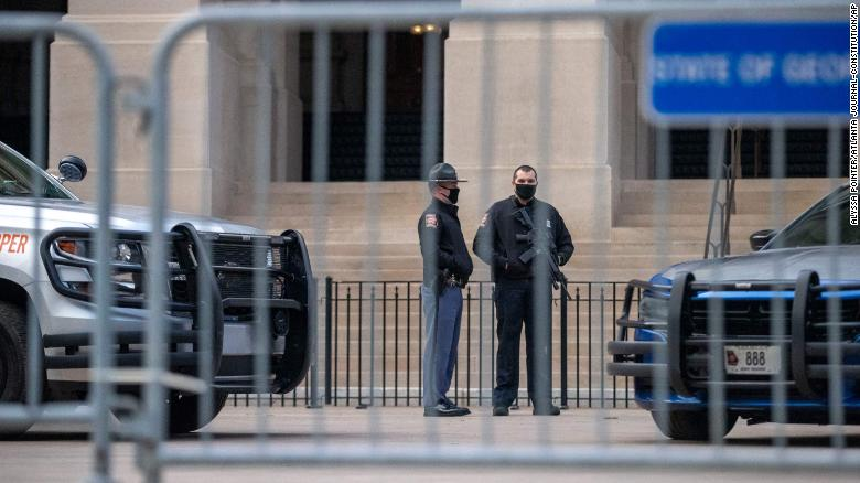 Georgia State Troopers stand guard in front of the Georgia State Capitol building on the first day of the 2021 legislative session in downtown Atlanta, Monday, Jan. 11, 2021.