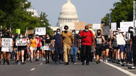 Demonstrators march down Pennsylvania Avenue during a protest against police brutality following the murder of George Floyd, on June 3, 2020, in Washington, DC.