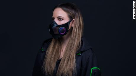 The reusable mask features a microphone and amplifier to enhance the wearer's voice.
