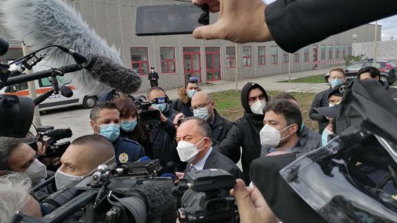 Italian anti-mafia prosecutor Nicola Gratteri, center, is surrounded by media as he arrives for the opening of the trial of more than 350 alleged members of the 'Ndrangheta mafia group and their associates in Calabria.