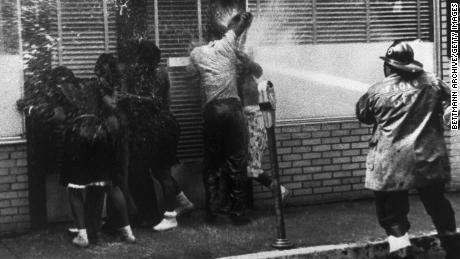 Firemen train their hoses on a group of African Americans while routing anti-segregation demonstrators in Birmingham, Alabama, in May 1963.