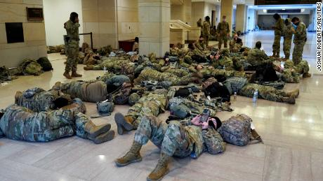 National Guard members sleep in the Capitol Vistor's Center on Capitol Hill before Democrats begin debating one article of impeachment against U.S. President Donald Trump at the U.S. Capitol, in Washington, U.S., January 13, 2021. REUTERS/Joshua Roberts