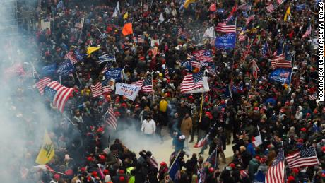Trump supporters clash with police and security forces as they storm the US Capitol in Washington D.C on January 6, 2021. - Demonstrators breeched security and entered the Capitol as Congress debated the a 2020 presidential election Electoral Vote Certification. (Photo by Roberto Schmidt/AFP/Getty Images)