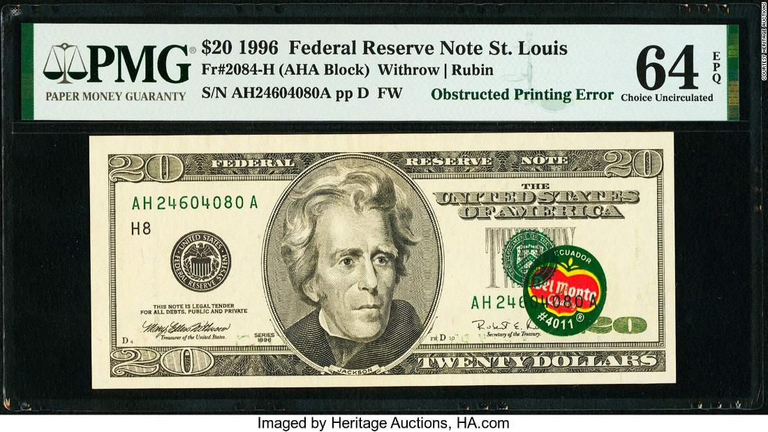 Auction bids are topping $57,000 for a rare $20 banknote with Del Monte sticker on it