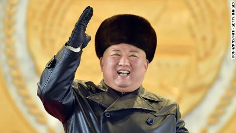 North Korean leader Kim Jong Un gesturing from the tribune during a military parade on Thursday.