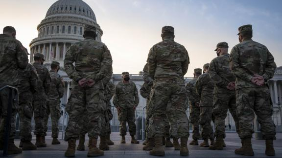 Members of the National Guard assemble outside of the U.S. Capitol in Washington, D.C., U.S., on Thursday, Jan. 14, 2021. President Trump's unprecedented second impeachment heads to the Senate, where his fate rests with Republican leader McConnell, who now has more leverage than ever over the president in his final week in office.