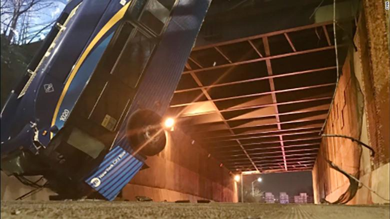 Bus is dangling from New York overpass after accident that left at least seven people injured