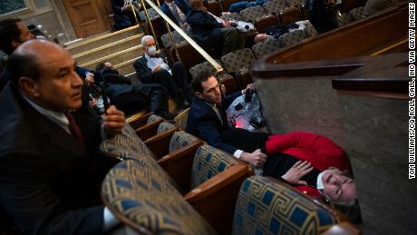 Representative Jason Crowe, a Democrat from Colorado, comforted Representative Susan Wilde, a Democrat from Pennsylvania, as he hid while the rebels seized the US Capitol on January 6.