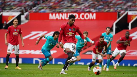 MANCHESTER, ENGLAND - JULY 04: Marcus Rashford of Manchester United scores his team's second goal from the penalty spot during the Premier League match between Manchester United and AFC Bournemouth  at Old Trafford on July 04, 2020 in Manchester, England. Football Stadiums around Europe remain empty due to the Coronavirus Pandemic as Government social distancing laws prohibit fans inside venues resulting in all fixtures being played behind closed doors. (Photo by Dave Thompson/Pool via Getty Images)