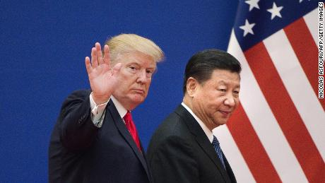 US President Donald Trumpand China's President Xi Jinping leave a business leaders event at the Great Hall of the People in Beijing on November 9, 2017.