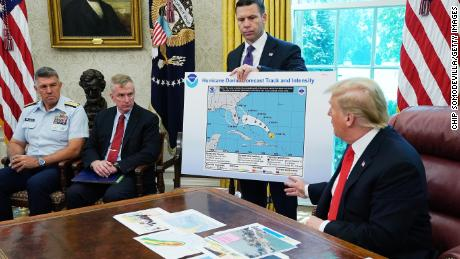 Trump references a map held by acting Homeland Security Secretary Kevin McAleenan while talking to reporters about Hurricane Dorian in the Oval Office at the White House September 4, 2019 in Washington, DC.