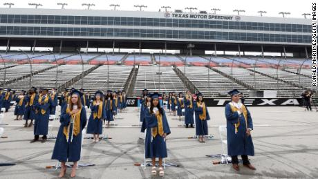 Little Elm High School graduates stand six feet apart from each other during graduation ceremonies at Texas Motor Speedway in Fort Worth on May 21.