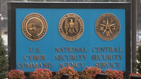 A sign for the National Security Agency (NSA), US Cyber Command and Central Security Service, is seen near the visitor