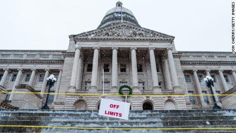 An off limits sign is seen at the steps of the state Capitol on Saturday in Frankfort, Kentucky.