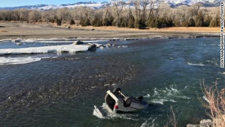 "Trooper Connor Wager tethered himself with a rope before entering the ""nearly freezing"" Yellowstone River, the Montana Highway Patrol said."
