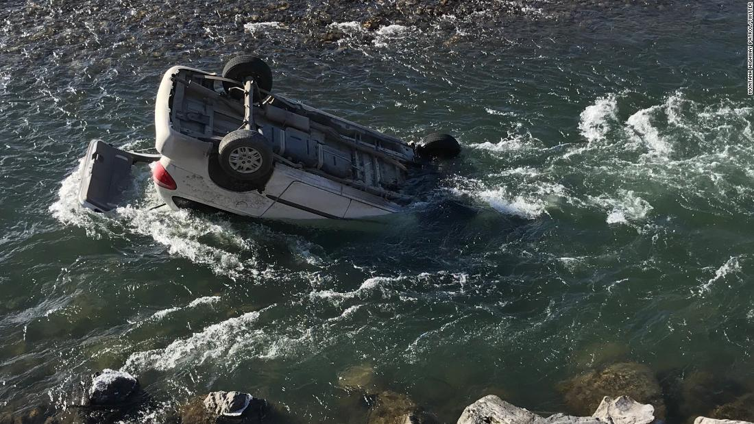 Trooper pulls driver from car submerged in icy river