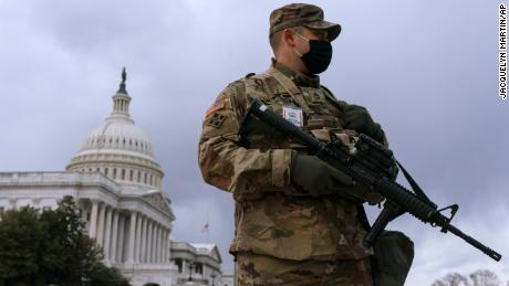 Tight security at mostly calm US capitols as Joe Biden is inaugurated