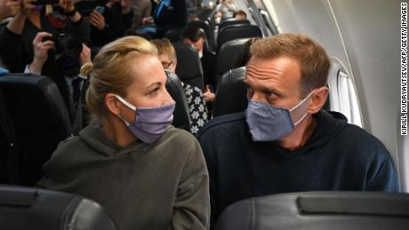 Russian opposition leader Alexey Navalny, right, and his wife, Yulia Navalnya, on a Pobeda airlines plane heading to Moscow before take-off from Berlin on Sunday.