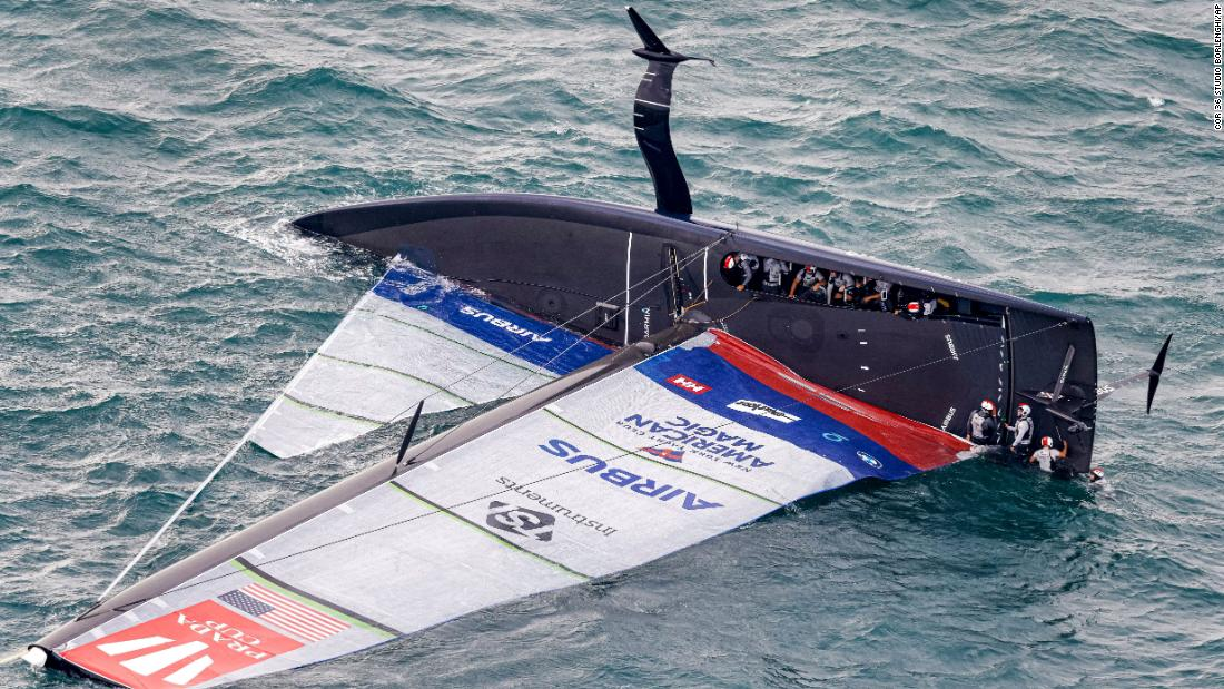 America's Cup: Patriot 'flying yacht' capsizes in gusty conditions