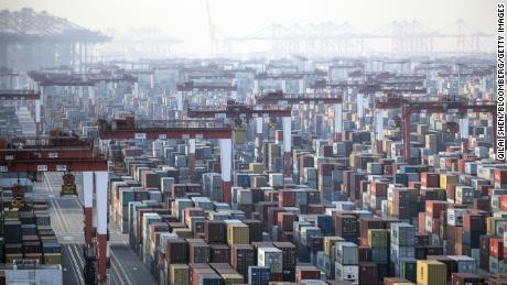 "Shipping containers next to gantry cranes at the Yangshan Deepwater Port in Shanghai, China, on Monday, Jan, 11, 2021. U.S. President Donald Trump famously tweeted that ""trade wars are good, and easy to win"" in 2018 as he began to impose tariffs on about $360 billion of imports from China. Turns out he was wrong on both counts. Photographer: Qilai Shen/Bloomberg via Getty Images"