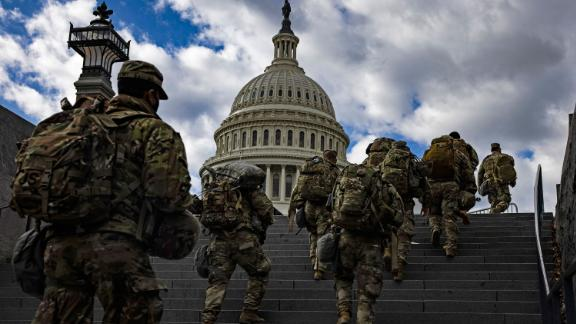 WASHINGTON, DC - JANUARY 17: National Guard soldier head to the east front of the U.S. Capitol from the Capitol Visitors Center on January 17, 2021 in Washington, DC. After last week's riots at the U.S. Capitol Building, the FBI has warned of additional threats in the nation's capital and in all 50 states. According to reports, as many as 25,000 National Guard soldiers will be guarding the city as preparations are made for the inauguration of Joe Biden as the 46th U.S. President. (Photo by Samuel Corum/Getty Images)