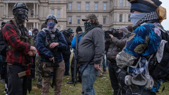 Members of the Michigan Boogaloo Bois an anti-government group stand with their long guns near the Capitol Building in Lansing, Michigan on January 17, 2021, during a nationwide protest called by anti-government and far-right groups supporting US President Donald Trump and his claim of electoral fraud in the November 3 presidential election. - The FBI warned authorities in all 50 states to prepare for armed protests at state capitals in the days leading up to the January 20 presidential inauguration of President-elect Joe Biden. (Photo by SETH HERALD / AFP) (Photo by SETH HERALD/AFP via Getty Images)
