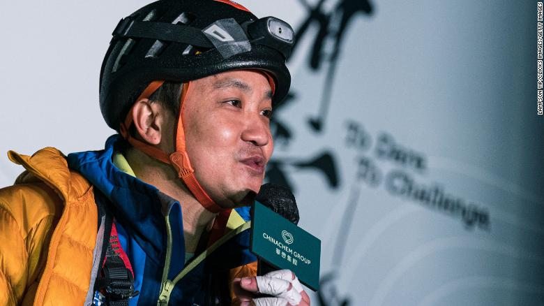 Lai Chi-wai talking to the press after climbing 250 meters (820 feet) up a skyscraper in Hong Kong on January 16.