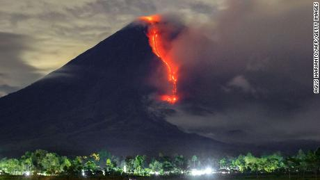 In this picture taken on January 16, 2021, lava is seen during an eruption of Mount Semeru in Lumajang, East Java.