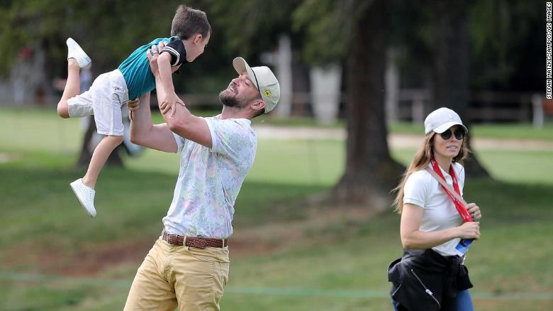 Justin Timberlake lifts up his son Silas next to his wife Jessica Biel at the Crans Montana Golf Club on August 27, 2019 in Crans-Montana, Switzerland.