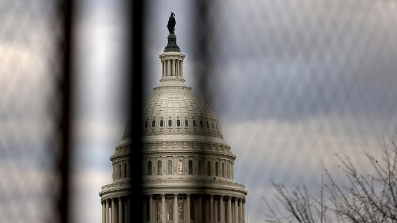 WASHINGTON, DC - JANUARY 17: The U.S. Capitol dome is seen beyond a security fence on January 17, 2021 in Washington, DC. After last week