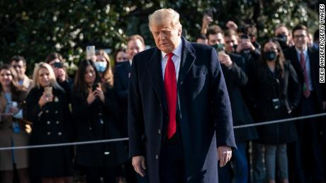 Trump turns to reporters as he exits the White House to walk toward Marine One on the South Lawn on January 12, 2021 in Washington, DC.