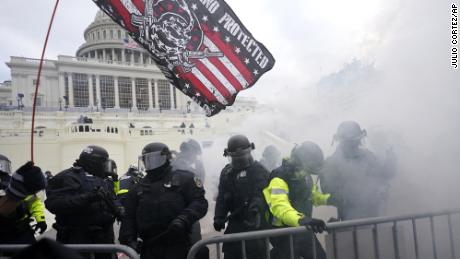 Police hold off Trump supporters who tried to break through a police barrier, Wednesday, January 6, 2021, at the Capitol in Washington.