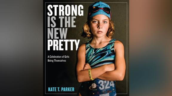 """In Kate T. Parker's book """"Strong Is the New Pretty: A Celebration of Girls Being Themselves"""" (Workman Publishing), girls share what makes them feel strong. """"When my mom showed me this shot, it made me believe I could be as tough as I look,"""" said Parker's daughter Ella, then 9, of the image on the cover. She was scared the night before her first triathlon when her mom took the photo."""